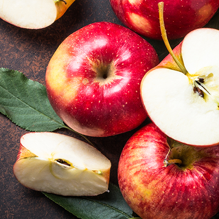 Fresh Red Appels cut on a wood surface